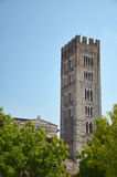 The tower of the Basilica of San Frediano, Lucca, Italy. The tower of the Basilica of San Frediano, Lucca, has openings that graduate in number, typical of Royalty Free Stock Image
