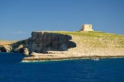 Tower bastioned on island Comino in Mediterranean Sea, Malta stock image