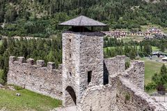 Tower and bastions of a stone fortress. Tower and bastions of a stone fort on a rock cliff overlooking the valley Stock Photos