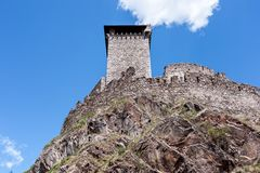 Tower and bastions of a stone fortress. Tower and bastions of a stone fort on a rock cliff Royalty Free Stock Image