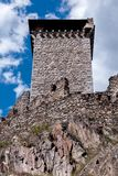Tower and bastions of a stone fortress. Tower and bastions of a stone fort on a rock cliff Stock Photos