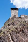 Tower and bastions of a stone fortress. Tower and bastions of a stone fort on a rock cliff Stock Photo