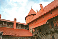 The Tower of the beautiful castle. With red roof Royalty Free Stock Photo