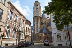 Tower of the Beguinage Church, Brussels. Brussels, Belgium - July 31, 2015: Tower of the Beguinage Church (XVII century, baroque style) and surrounding streets royalty free stock photo
