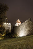 Tower behind castle walls. Olc castle on a riverbank in Narva, Estonia Stock Photos