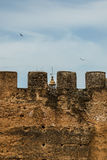 A tower behind a tower in Caceres Stock Photo