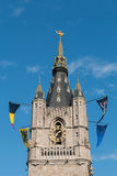 Tower of the Belfry of Ghent, Belgium. Tower of the Belfry of Ghent in Flanders, Belgium - closeup Stock Photo