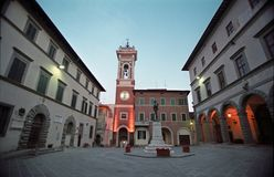 Tower bell at a little square. In Italy Stock Photos