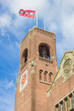 Tower of the Berlage building and flag in Amsterdam Royalty Free Stock Photos