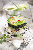 Tower of black and white rice with shrimp and zucchini Royalty Free Stock Photos
