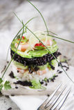 Tower of black and white rice with shrimp and zucchini Stock Images