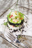 Tower of black and white rice with shrimp and zucchini Royalty Free Stock Photography