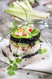 Tower of black and white rice with shrimp and zucchini Stock Photography