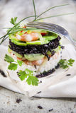 Tower of black and white rice with shrimp and zucchini Stock Photos