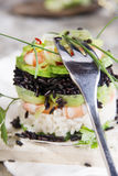 Tower of black and white rice with shrimp and zucchini Royalty Free Stock Images