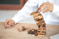 Tower block, falling block, risk management, business concept, royalty free stock image