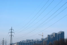 Tower blocks with cranes and wires Royalty Free Stock Photo