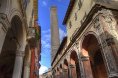 Tower of Bologna, Italy. Tall medieval tower of Bologna, Italy, seen from the Strada Maggiore street Stock Photos