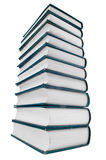 Tower of books isolated on white background. Vertical stack of many books isolated on white background.wide angle Stock Photo