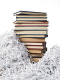 Tower books on strips paper. Tower books on white background and a background of strips of paper Stock Photos