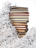 Tower books on strips paper. Tower books on white background and a background of strips of paper stock image