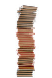 Tower of books on a white background Royalty Free Stock Photo