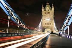 The Tower Bridge. Traffic on The Tower Bridge at night in London, UK Royalty Free Stock Photo
