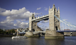 Tower Bridge. Boat passing under Tower Bridge, London, England stock photo