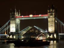 Tower bridge. The famous Tower bridge at night in central London. Here you can see it opening royalty free stock photography