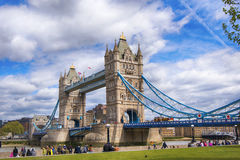 Tower bridge against cloudy sky. Tower bridg and Thames river against cloudy sky in London Royalty Free Stock Photo