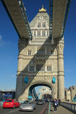Tower Bridge arch view with cars, London. A eastwards view through the arches of Tower Bridge in London, England, United Kingdom Stock Photos
