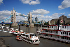 Tower Bridge with boat, London, UK Stock Photo