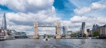 Tower Bridge with Business district and cityhall panoramic view. View from the thames river to the tower bridge on a cloudy day in london. ideal for websites and stock photography