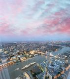 Tower Bridge and city skyline along river Thames at night, aeria. L view - London - UK Stock Photography