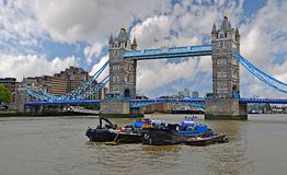 Tower Bridge with Clouds and Canary Wharf Stock Images
