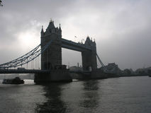 Tower Bridge clouds and sun. Famous Tower Bridge in London in cloudy weather Royalty Free Stock Photos