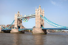 Tower bridge decorated with Olympic rings. Landmark Tower bridge on river Thames decorated with symbol 5color rings  before Olympic games in London 2012 Great Royalty Free Stock Photography