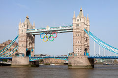 Tower bridge decorated with Olympic rings. Landmark Tower bridge on river Thames decorated with symbol 5color rings  before Olympic games in London 2012 Great Royalty Free Stock Photo
