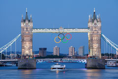 Tower bridge decorated with Olympic rings London. Landmark Tower bridge on river Thames illuminated and decorated with symbol 5color rings  before Olympic games Royalty Free Stock Image