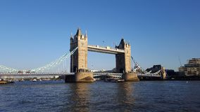 Tower Bridge in the early evening. Tower Bridge and the Thames River in the early evening, London, UK royalty free stock photo