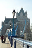 Tower Bridge entrance: lantern perspective. Perspective of Tower Bridge entrance along the pedestrian pathway and fence decorated with lanterns, London, United Stock Image