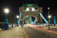 Tower Bridge entrance perspective at night, London. Night view of empty Tower Bridge, without traffic, London, England, United Kingdom. The picture looks also Stock Photos