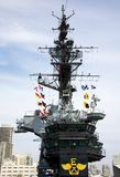 Tower, bridge and flags on the USS Midway Stock Photos