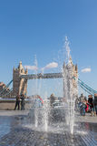 Tower Bridge and fountains. LONDON, UK - MARCH 25, 2016: Fountains, tourists and Tower Bridge Royalty Free Stock Photos