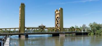 Tower Bridge Gateway across Sacramento River in California. Yellow drawbridge known as Tower Bridge Gateway across Sacramento river in Capital of California royalty free stock photo