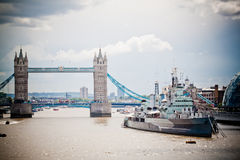 Tower Bridge and HMS Belfast. The warship turned into a museum, seen from London Bridge on a stormy summer morning Stock Photography