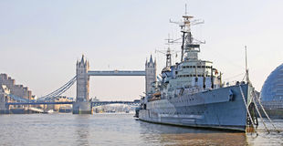 Tower Bridge & HMS Belfast. Tower Bridge is the most famous of the bridges crossing the River Thames. It is shown here with the decommissioned HMS Belfast that Stock Images