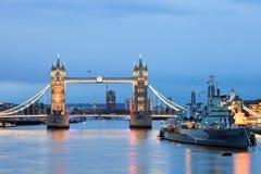Tower Bridge and HMS Belfast. London cityscape with Tower Bridge and HMS Belfast at dusk Stock Photography