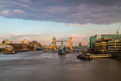 Tower Bridge and HMS Belfast in London at sunrise Stock Images