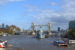 Tower Bridge and HMS Belfast. A picture of the iconic Tower Bridge and in front of it the HMS Belfast war ship on the Thames river in London. Picture is great to Stock Photo